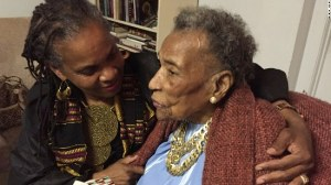 "Amelia Boynton Robinson, 103, chats with activist Faya Rose Toure before a special screening of ""Selma"" at Boynton Robinson's home in Tuskegee, Alabama."