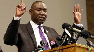 FILE - In this Monday, Aug. 18, 2014, file photo, Brown family attorney Benjamin Crump speaks during a news conference in St. Louis County, Mo. Legal experts say a cellphone video that shows a witness raising his hands in the air immediately after shooting - The Associated Press