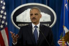 Attorney General Eric Holder speaks at the Justice Department in Washington on Wednesday, March 4, 2015, about the department's findings related to two investigations in Ferguson. (AP Photo/Carolyn Kaster)