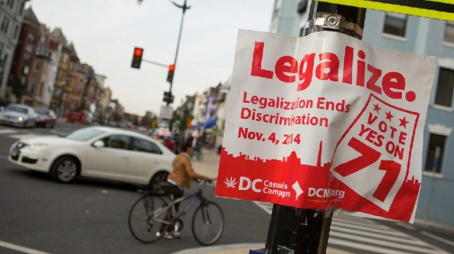 Early results showed more than a 2-1 lead for a measure to make recreational marijuana use legal in Washington, D.C. A sign promoting the initiative is seen on a corner in the Adams Morgan neighborhood Tuesday. - photo by Allison Shelley/Getty Images