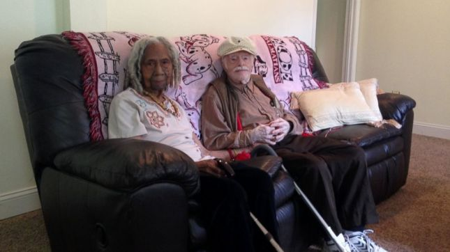 FILE - In this Aug. 5, 2014 file photo, 96-year-old Edith Hill and 95-year-old Eddie Harrison are seen in their home in Annandale, Va. A 95-year-old newlywed Virginia man has died just weeks after his 96-year-old wife was taken away by family members to Florida. Rebecca Wright, who was caring for the couple in their Alexandria, Virginia, home, says Eddie Harrison died Tuesday in a hospital after suffering from influenza. Wright says Harrison was distressed after his wife and longtime companion, 96-year-old Edith Hill, was taken away. Wright is Hill's daughter. (AP Photo/Matthew Barakat, File) The Associated Press