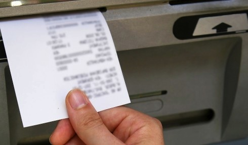 An ATM receipt with blurred information, from Shutterstock