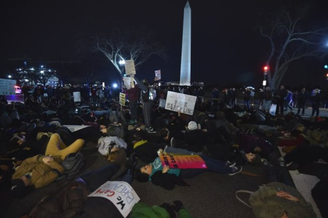 Protesters participate in a die-in near the Washington Monument on Dec. 4 in Washington, D.C., following the grand jury decision not to indict the police officer involved in the death of Eric Garner.